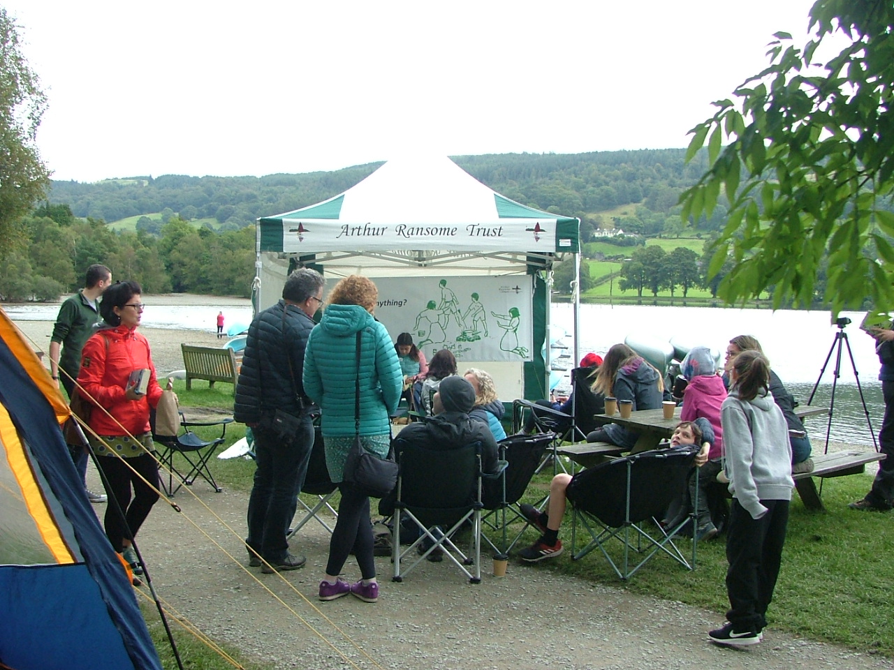 A reader and audience at the live reading by Coniston Water