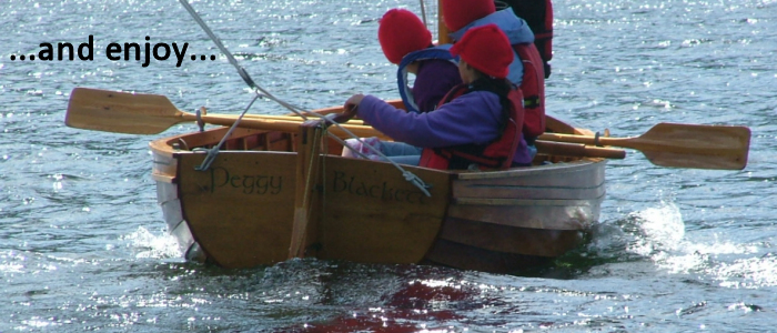 Photo of a traditional sailing dinghy on Coniston Water
